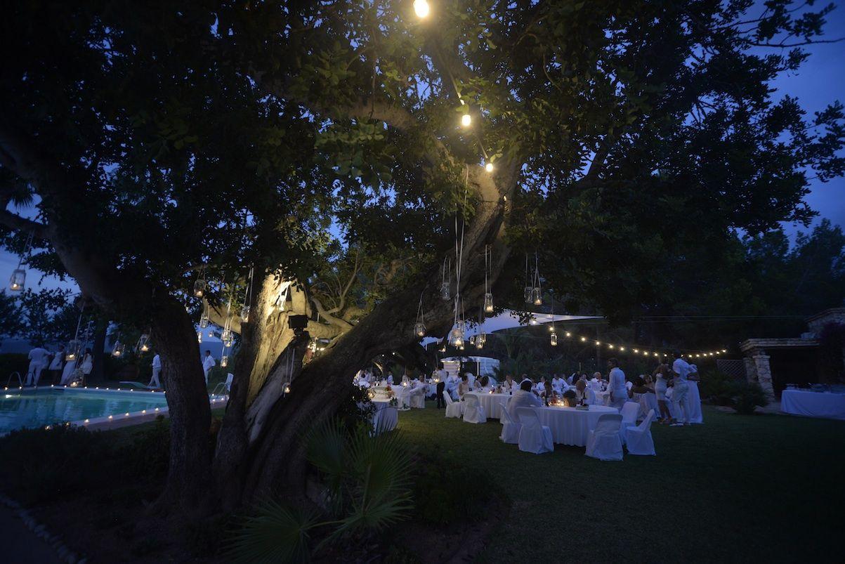 Wedding Reception in Ibiza. Big villa garden. Sant'Anonio bay view. White theme Party.
