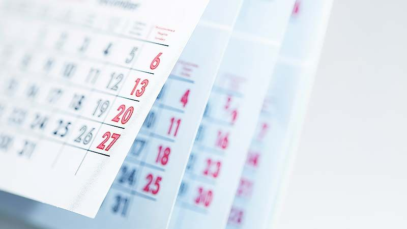 Months And Dates Shown On A Calendar Whilst Turning The Pages With