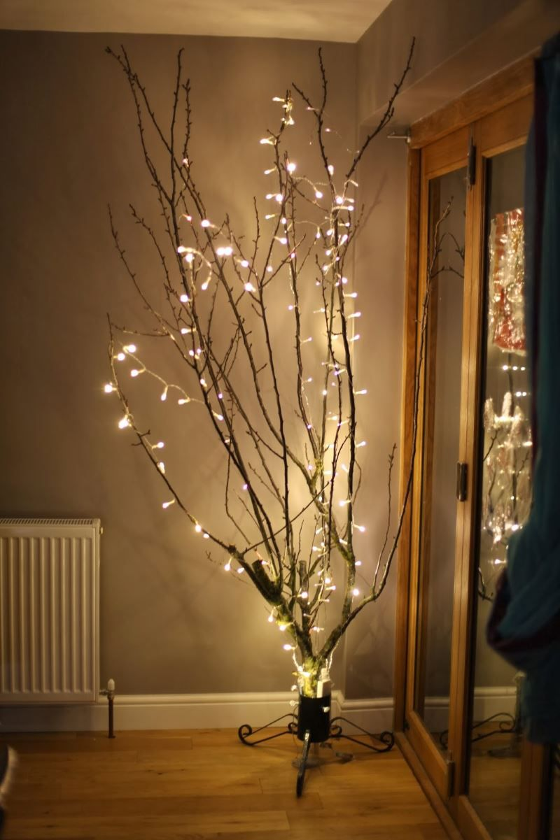 Keep The Holiday Glow Alive With These Winter Decor Ideas Branch Decor Tree Branch Decor Lighted Tree Branches
