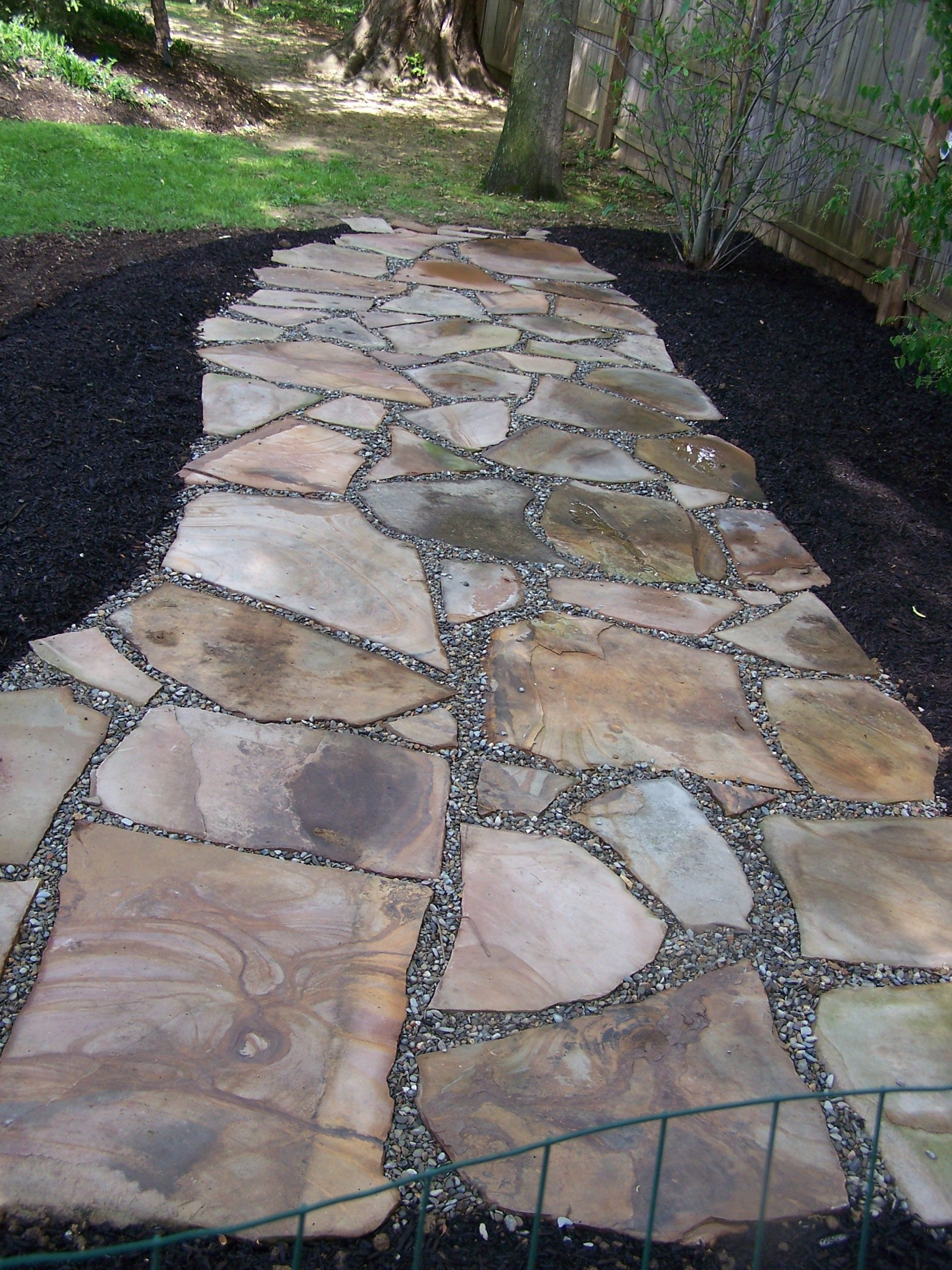 Irregular Natural Stone Permeable Patio With Pea Gravel Joints