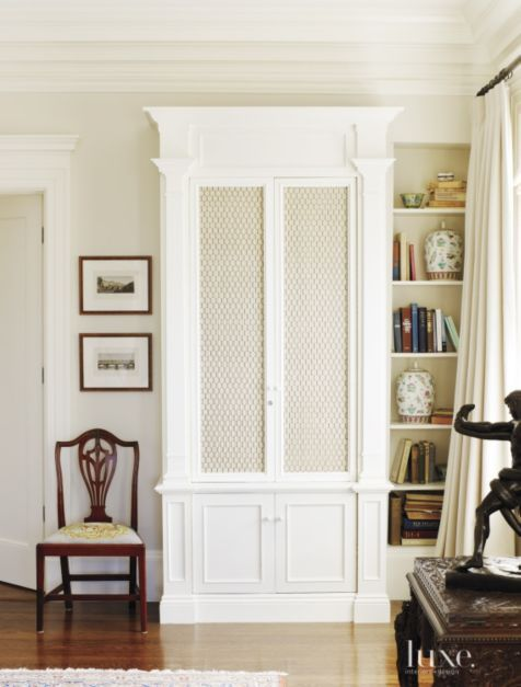 Standing in a corner of the master bedroom, a tall white cabinet and custom bookcase were designed by the owner to represent a scaled-down version of the library shelves in the monastery of San Giorgio Maggiore in Venice.