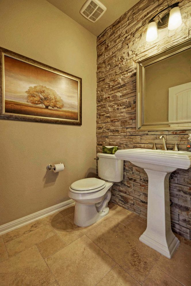 stone accent wall in the bathroom adds class and needs minimal ...