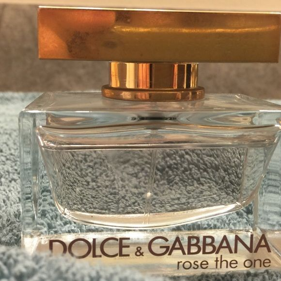 Dolce & Gabbana Rose The One Perfume 1.6 fl. oz perfume from Dolce & Gabbana. Rose the One sprayed less than 5 times. My fingertip indicates fill line. Do not have box any longer. Make an Offer! Next day shipping!  Dolce & Gabbana Other