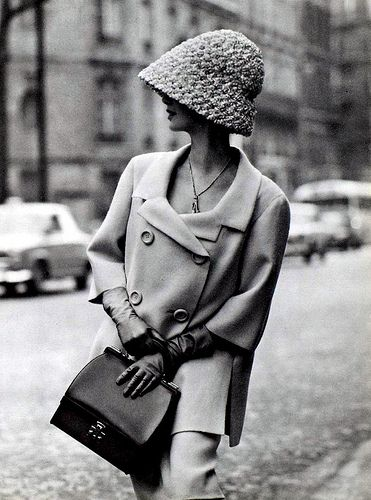 Model in double-breasted Shetland crême wool suit with longer,loose jacket, 3/4 sleeves by Jean Patou, gloves and purse by Hermès, photo by Georges Saad, Paris, 1962 #vintagefashion1950s