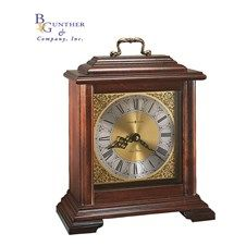 Medford Mantel :: Finished in Windsor Cherry on select hardwoods and veneers. This classic English bracket clock with a brass finished handle has a brass-finished Roman numeral dial featuring a silver chapter ring, spun brass center ring, and floral decorated corner spandrels. Quartz, battery-operated, dual-chime Kieninger movement plays full Westminster or Ave Maria chimes with strike on the hour, and other features #clock #timepiece #gift #personalized #retirement #recognition #business