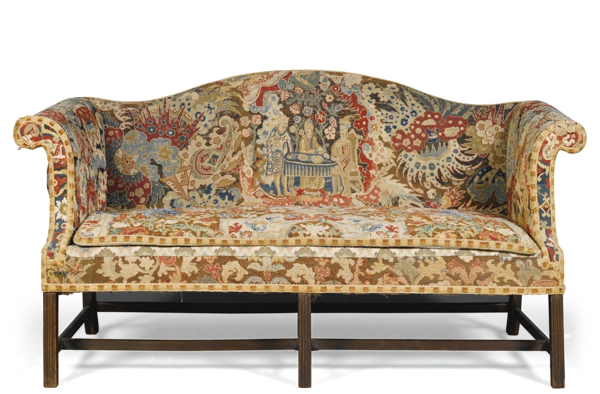 A fabulous needlepoint covered camelback sofa