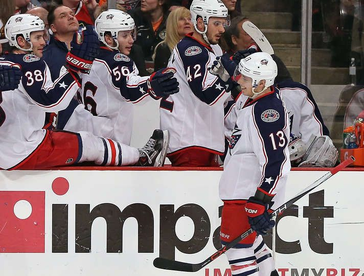 Blackhawks vs. Blue Jackets - 03/27/2015 - Columbus Blue Jackets - Photos.   Cam Atkinson #13 of the Columbus Blue Jackets celebrates with teammates after scoring empty net goal in the third period for a hat-trick against the Chicago Blackhawks at the United Center on March 27, 2015 in Chicago, Illinois. The Blue Jackets defeated the Blackhawks 5-2.