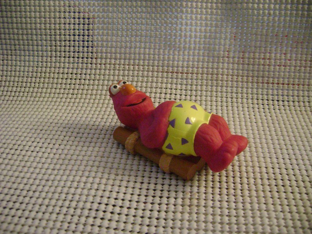 Sesame Street TELLY MONSTER pink on raft toy figure muppets vintage hard plastic