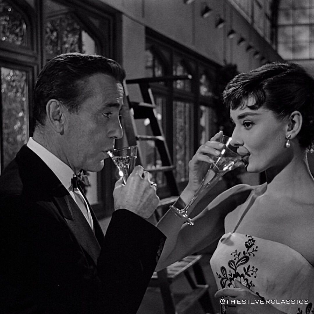 The Silver Classics Sur Instagram Cheers To The Weekend Humphrey Bogart As Linus Larrabee And Audrey Hepburn As S In 2020 Humphrey Bogart Audrey Hepburn Bogart