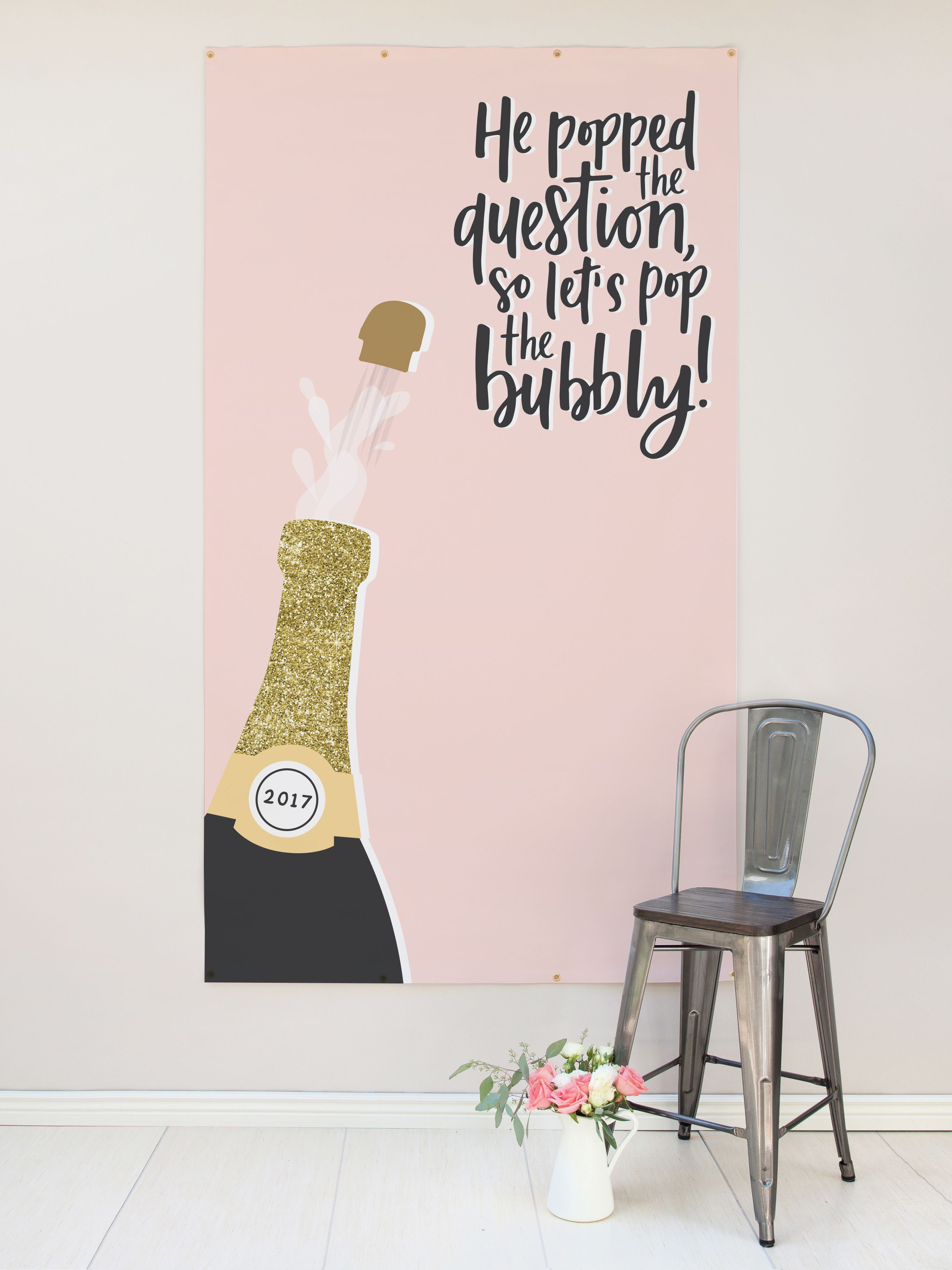 Our Engagement Party Backdrop features handmade calligraphy with illustration, and makes the perfect engagement party decor.