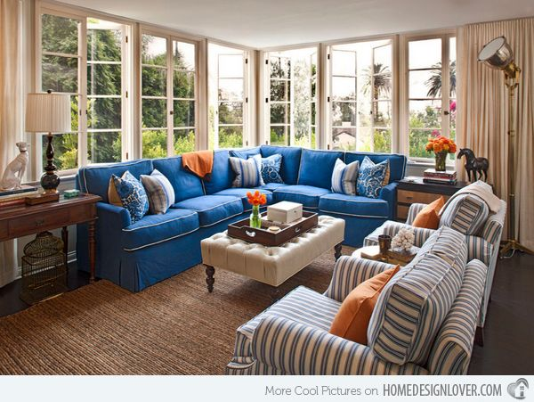 15 Stunning Living Room Designs With Brown Blue And Orange Accents Home Design Lover Blue Sofas Living Room Blue Sofa Living Family Room Design