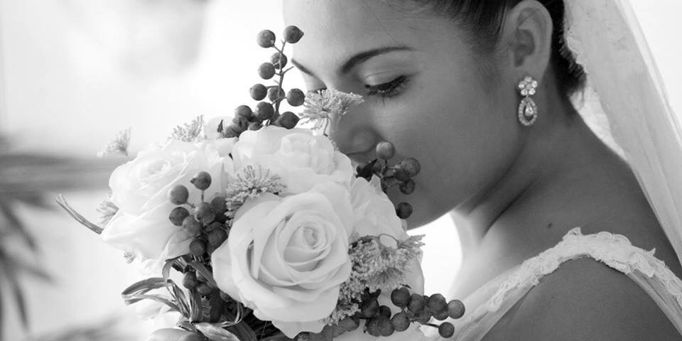 Cris&André. My bridal bouquet was made up of roses. The big secret is that it was an artificial professional bouquet.