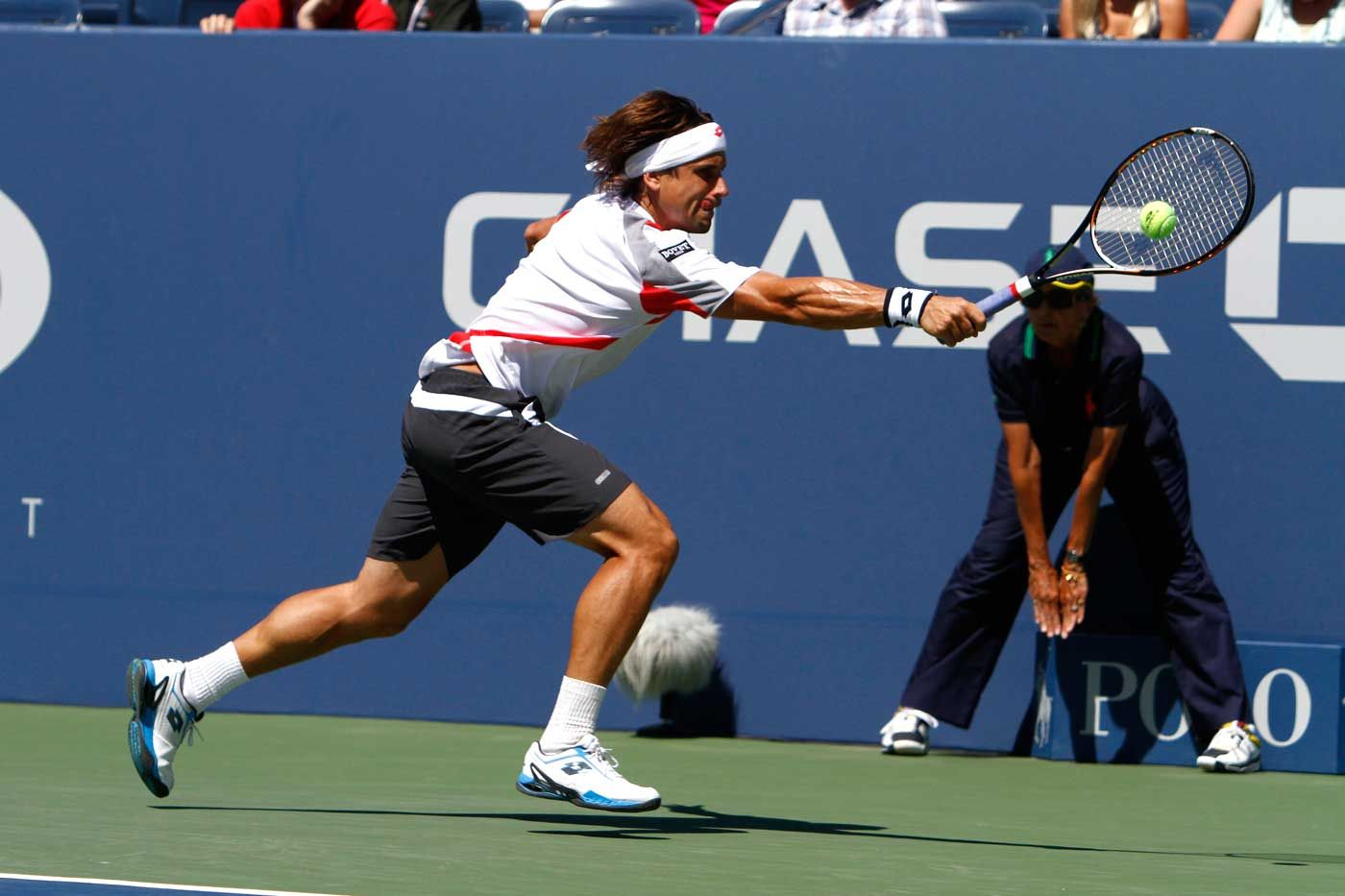 David Ferrer (ESP)[4] in action against Kevin Anderson (RSA) in the first round of the US Open. - Philip Hall/USTA
