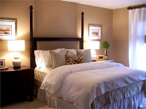 Nice warm wall colour, minimalist decor - I think I will avoid bedside lamps use wall sconces instead