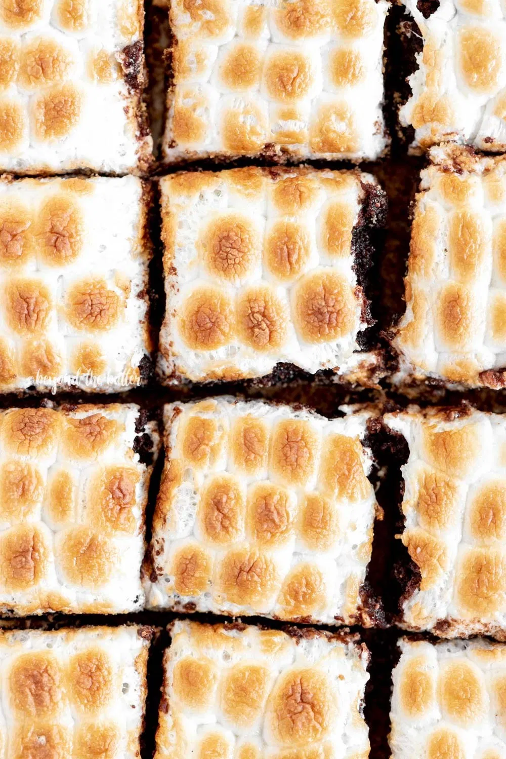 S'mores Brownies These LAYERED S'MORES BROWNIES are the perfect way to elevate that classic summer treat into something a little fancy! This decadent dessert is layered with toasted mini marshmallows, fudgy brownies with Ghirardelli Milk Chocolate Caramel Squares inside, followed by a buttery, graham cracker cr