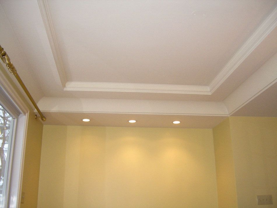 I like the canned lights installed at the end of the room for Coffered ceiling styles