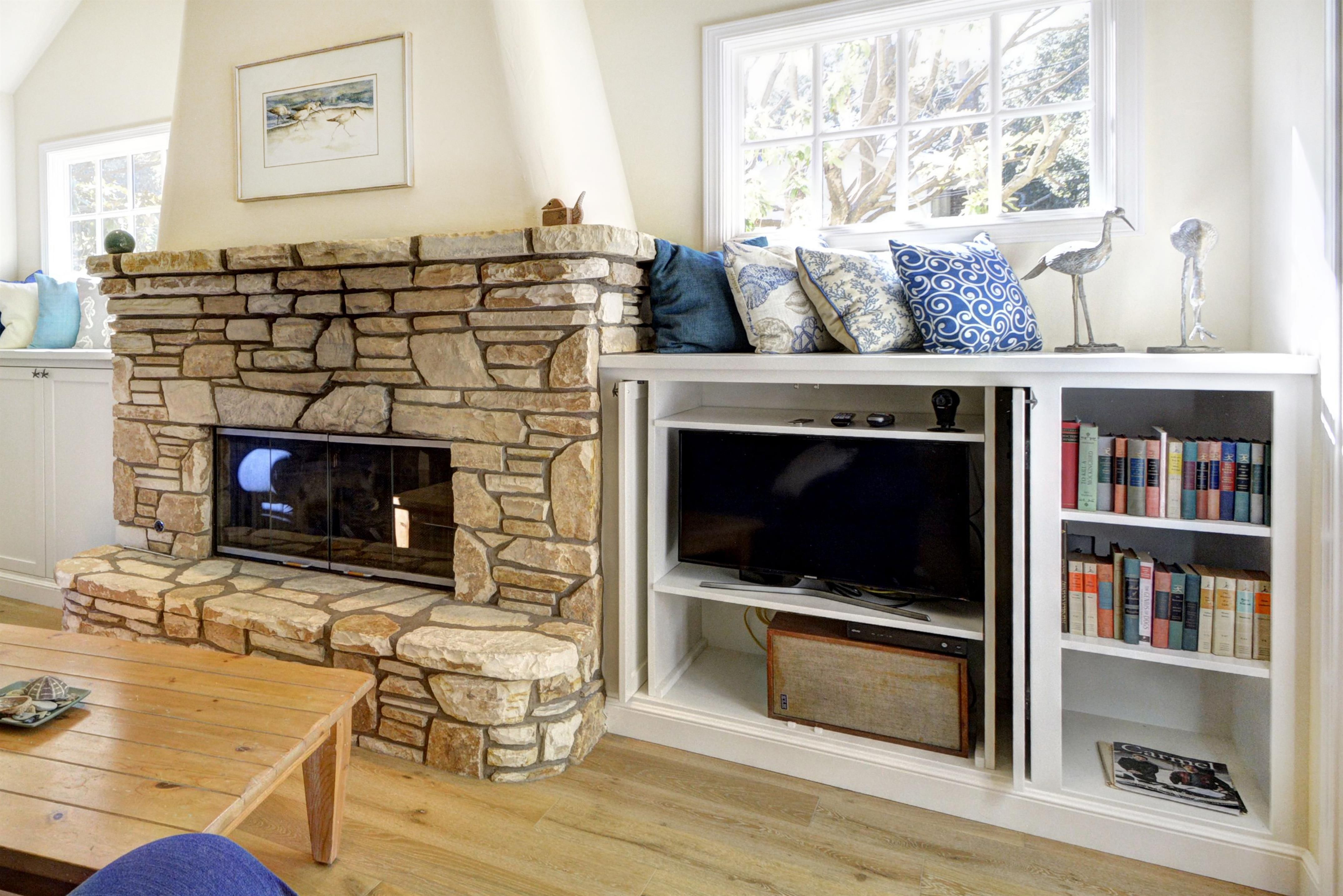 Stone fireplace with shelves