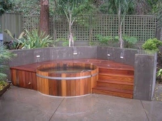 Round tub with raised deck 48 awesome garden hot tub for Circular garden decking