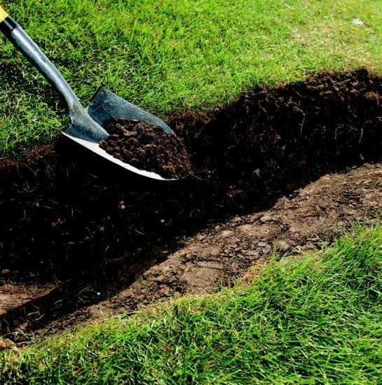 Got Drainage Issues? Digging A Swale Like This One Can Fix