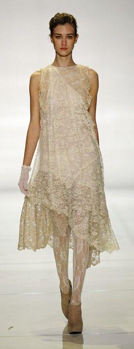 lace..cream colored dress. Designer?