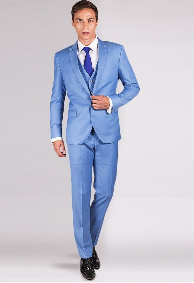 THE BROSNAN - SKY BLUE 3 PIECE SUIT Incorporate a sharp modern look into your everyday line up with this 3 piece precision cut, sky blue wool suit. Versatile and stylish it can be effortlessly matched with any shirt in your closet for the office or a casual evening out.
