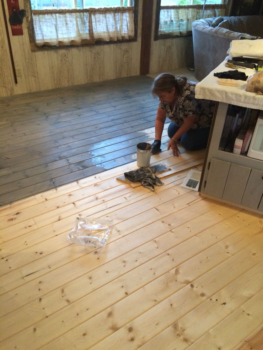 Pine tongue and groove as flooring stained light gray