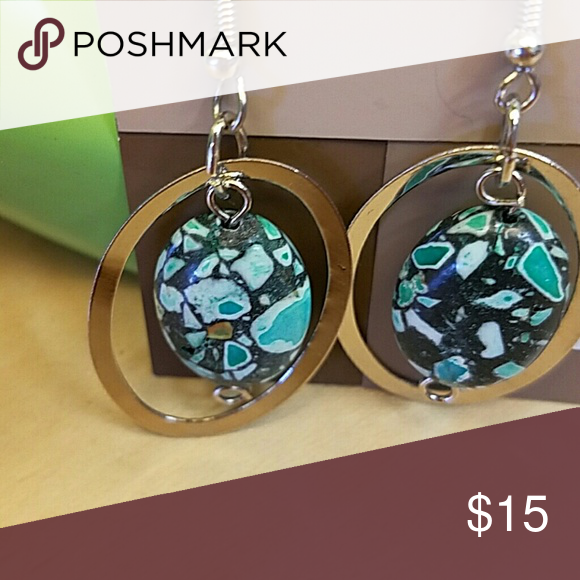 EARRINGS Lab created turquoise-look stone in closed by oval rhodium silver colored metal Hook style  earrings. Accessories