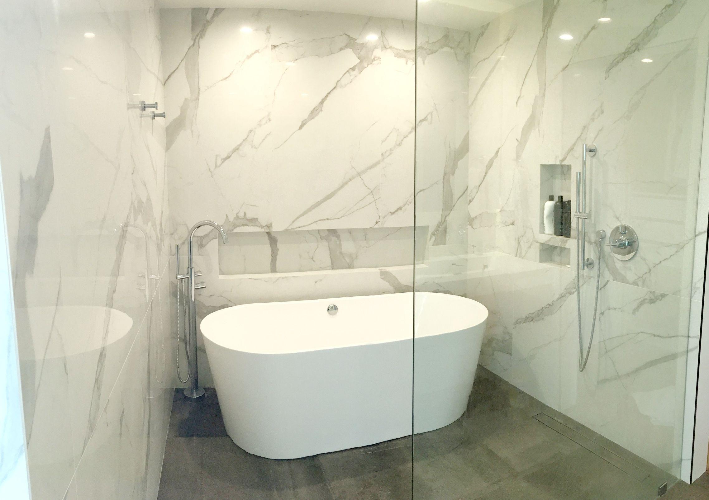 Open concept bathroom with floor to ceiling Italian porcelain tiles ...