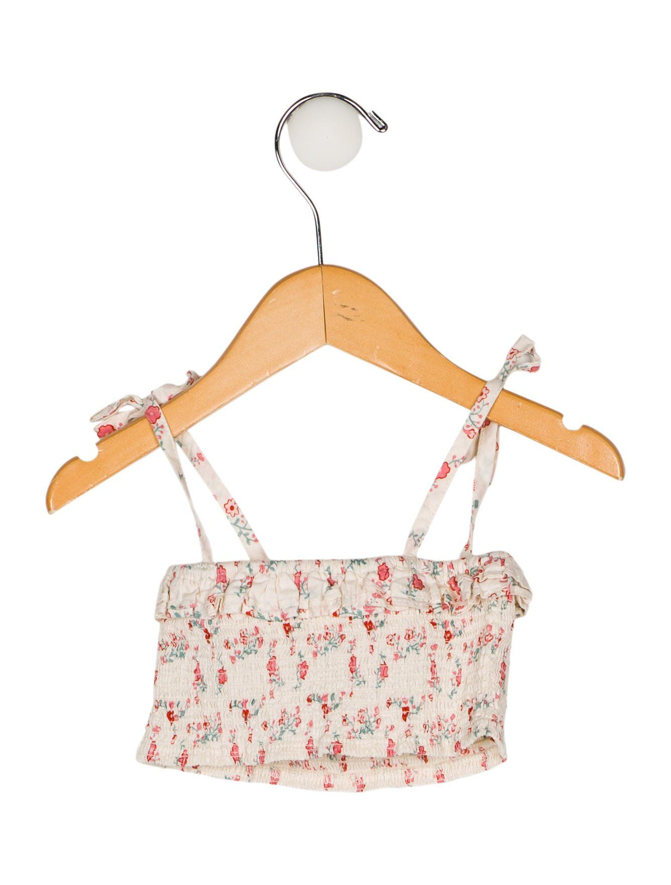 8a0da60716d Toddler girls' creme and pink Oeuf two-piece swimsuit set with floral print  throughout. Top features tie accents at straps and ruffle trim.