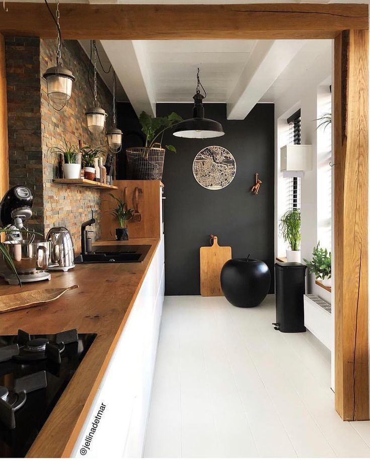 Stone And Wood Make A Dark Masculine Interior: Black Accent Wall In The Kitchen. Stone, White, Natural