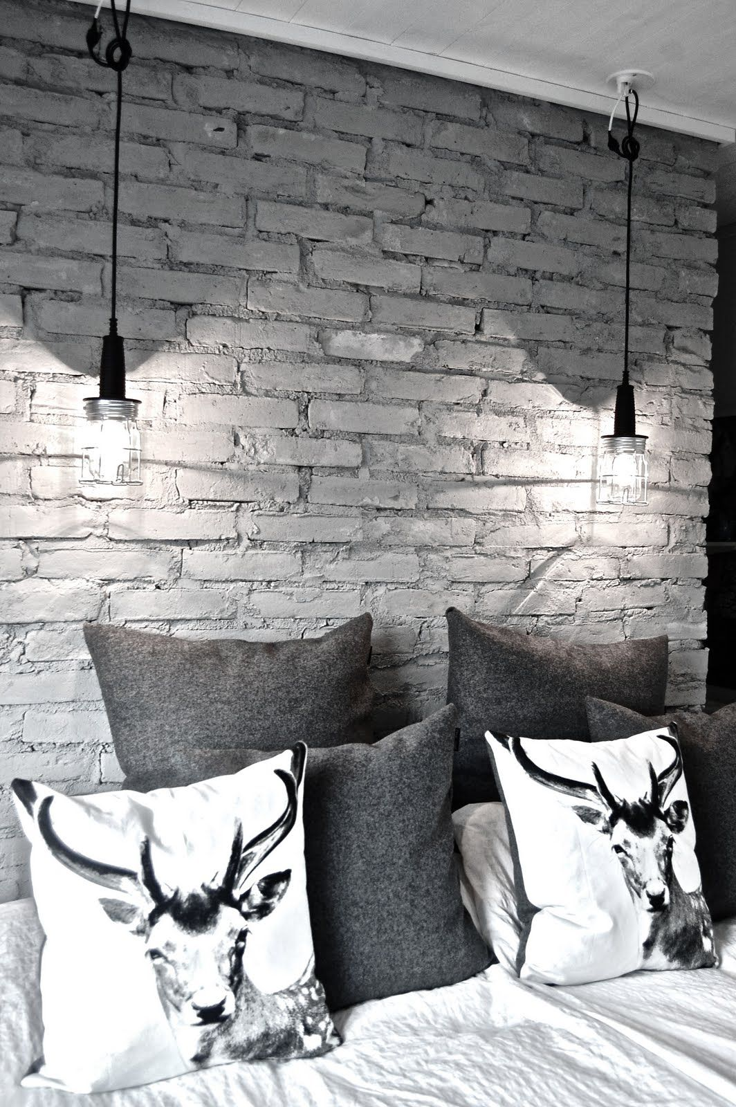 16 Beautiful Exposed Brick Wall Bedroom Ideas Stylish Design With Animal Print Pillows And Two Hanging Lamps Al