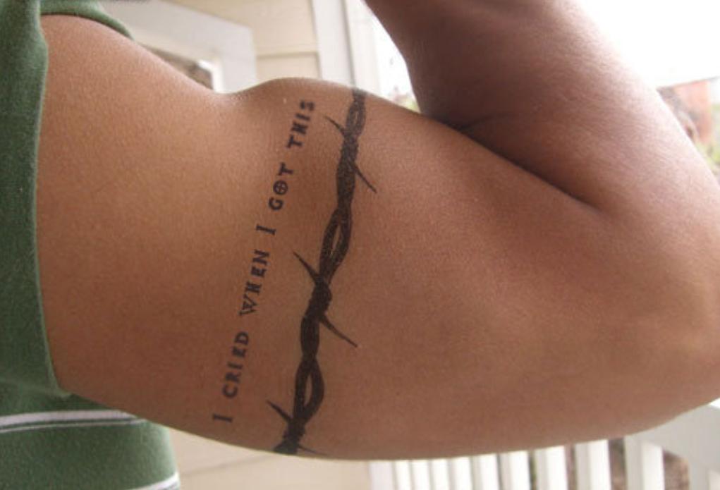 Nice Fence Tattoo On Upper Arm Tatuajes De Cowboy Tatuajes