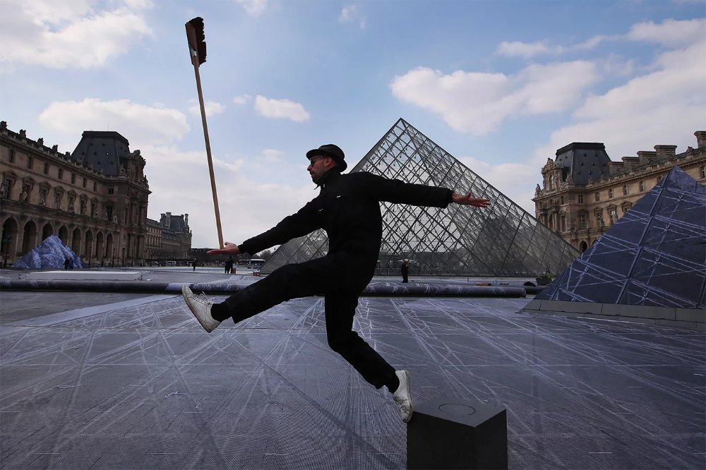 The Louvre Transformed Large Scale Optical Illusion