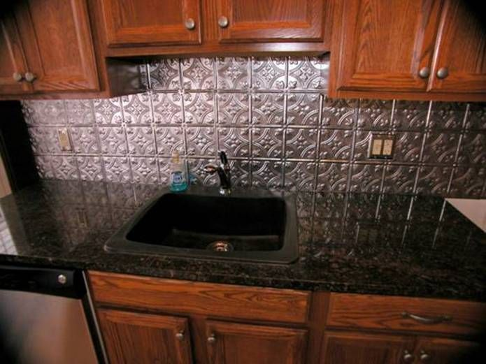 Black Granite Countertops with tin look Backsplash | Ontario ...