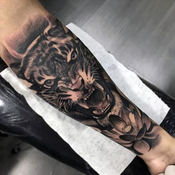 Realistic Grey Lotus Flower And Tiger Tattoo On Forearm Tattoo