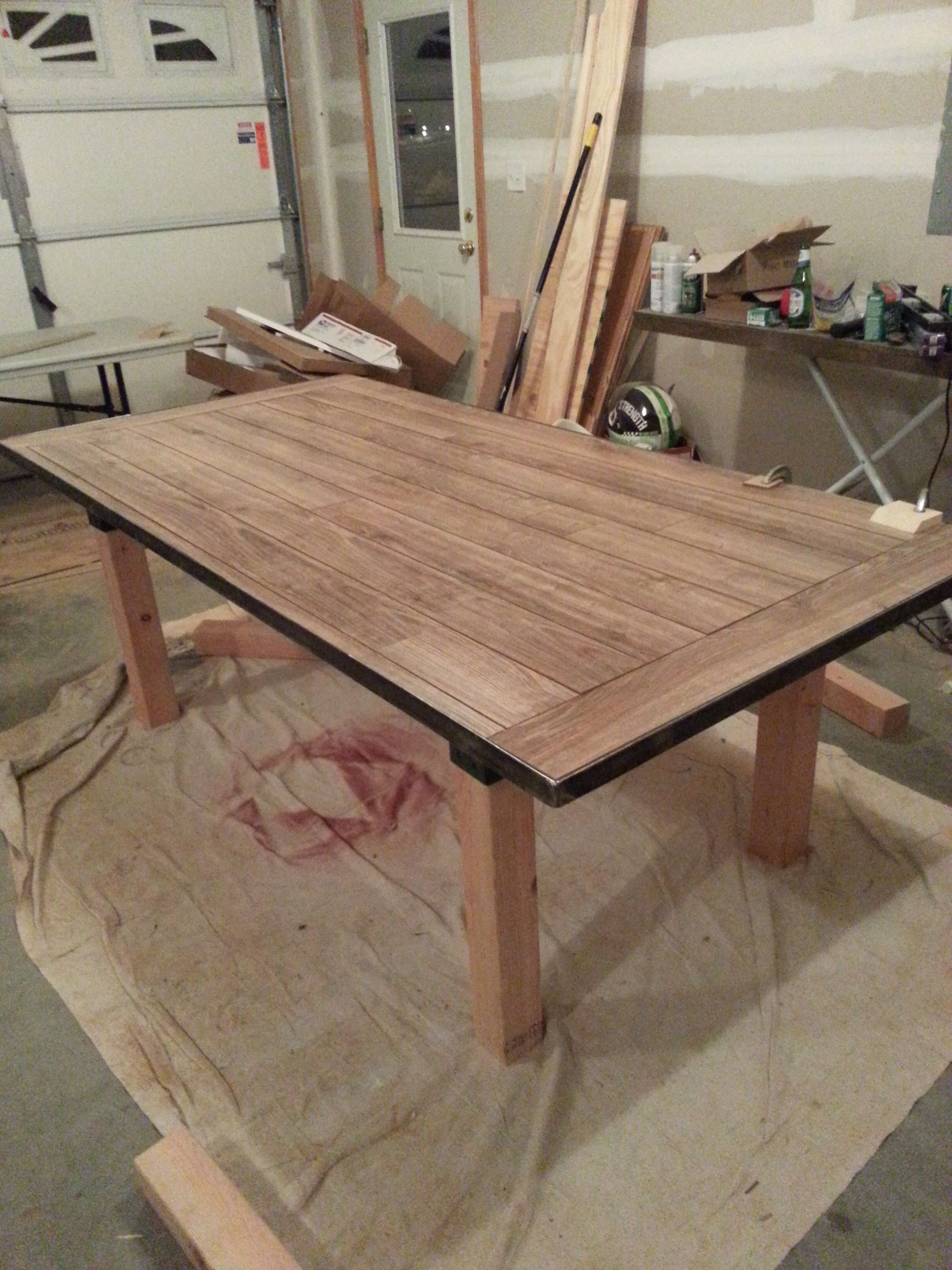 Laminate Flooring As The Table Top Within A Steel Frame