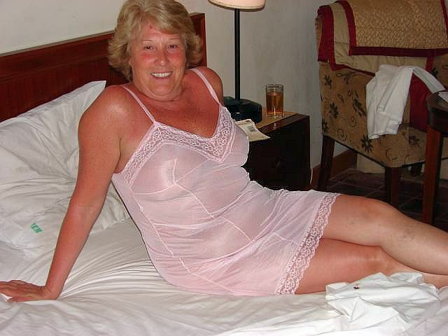 Mature lady laying on the bed