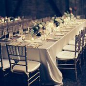 Elegant King's Tables set in ivory and creams - at THE MOUNTAIN WINERY in THE GRAND HALL / Saratoga, CA Wedding Venue Marina Koslow Photography