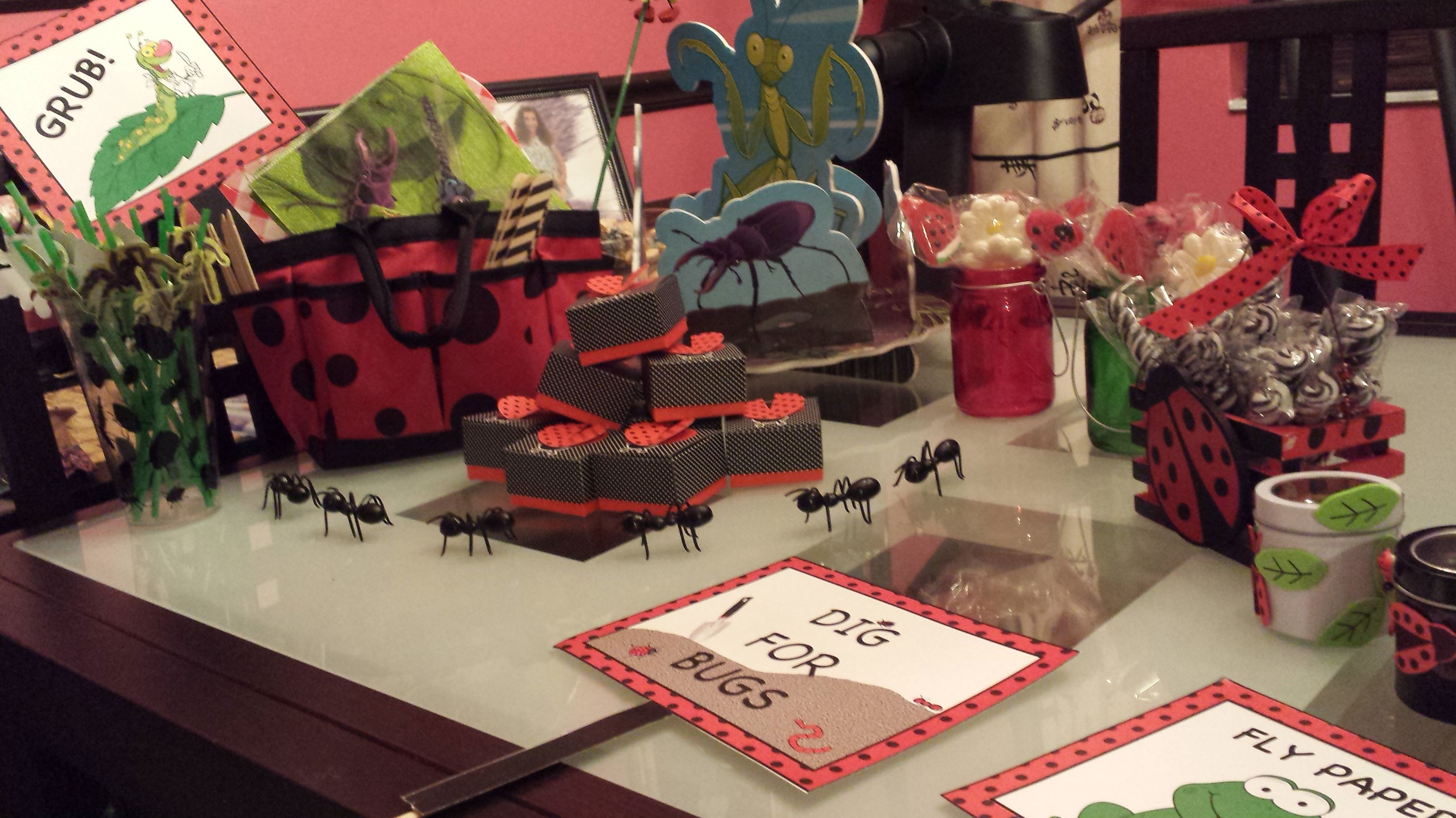We placed Godiva chocolates in the ladybug boxes for the adults. They were stacked on a three teared cake stand.