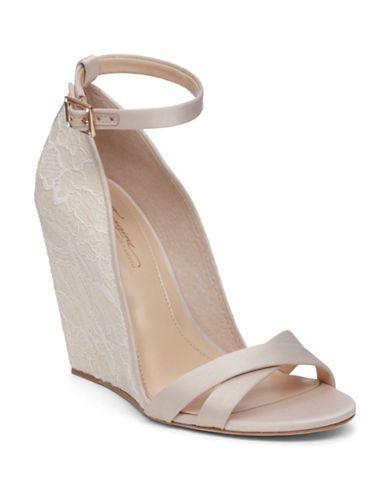 """<ul> <li>Alluring wedge sandals with florish lace details</li>  <li>Self-covered wedge heel, 3.9""""</li>  <li>Textile upper</li>  <li>Floral lace detail</li>  <li>Open toe</li>  <li>Double adjustable ankle straps</li>  <li>Synthetic lining</li>  <li>Leather sole</li>  <li>Imported</li>   </ul>"""