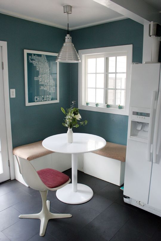 Molly & Tyler's Classic Cool Cottage | ApartmentTherapy -- I would do this banquette with a large geometric print fabric in teal and an ash, maple, or cherry (my holy trinity of woods) table with low elegant legs instead of a pedestal base. But I love the white and teal with a pop of pink, the Chicago word-map print, the tiny tea-lights, and the modern/industrial light fixture.