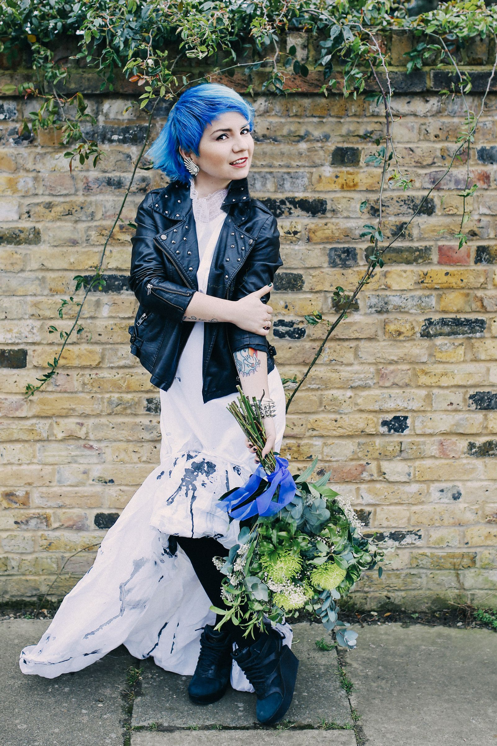 Blue haired bride in alternative designer wedding dress by paulina blue hair dress by unicorn tattoo modern and artistic wedding photography by joasis journal blue hair tattoos unique wedding dress massive green izmirmasajfo Image collections