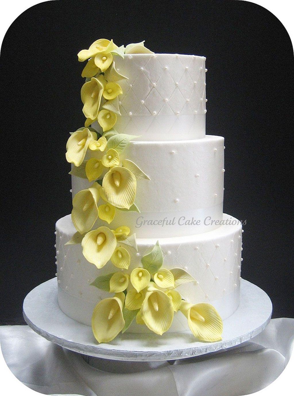 Elegant White Wedding Cake With Yellow Calla Lilies Flower Trail