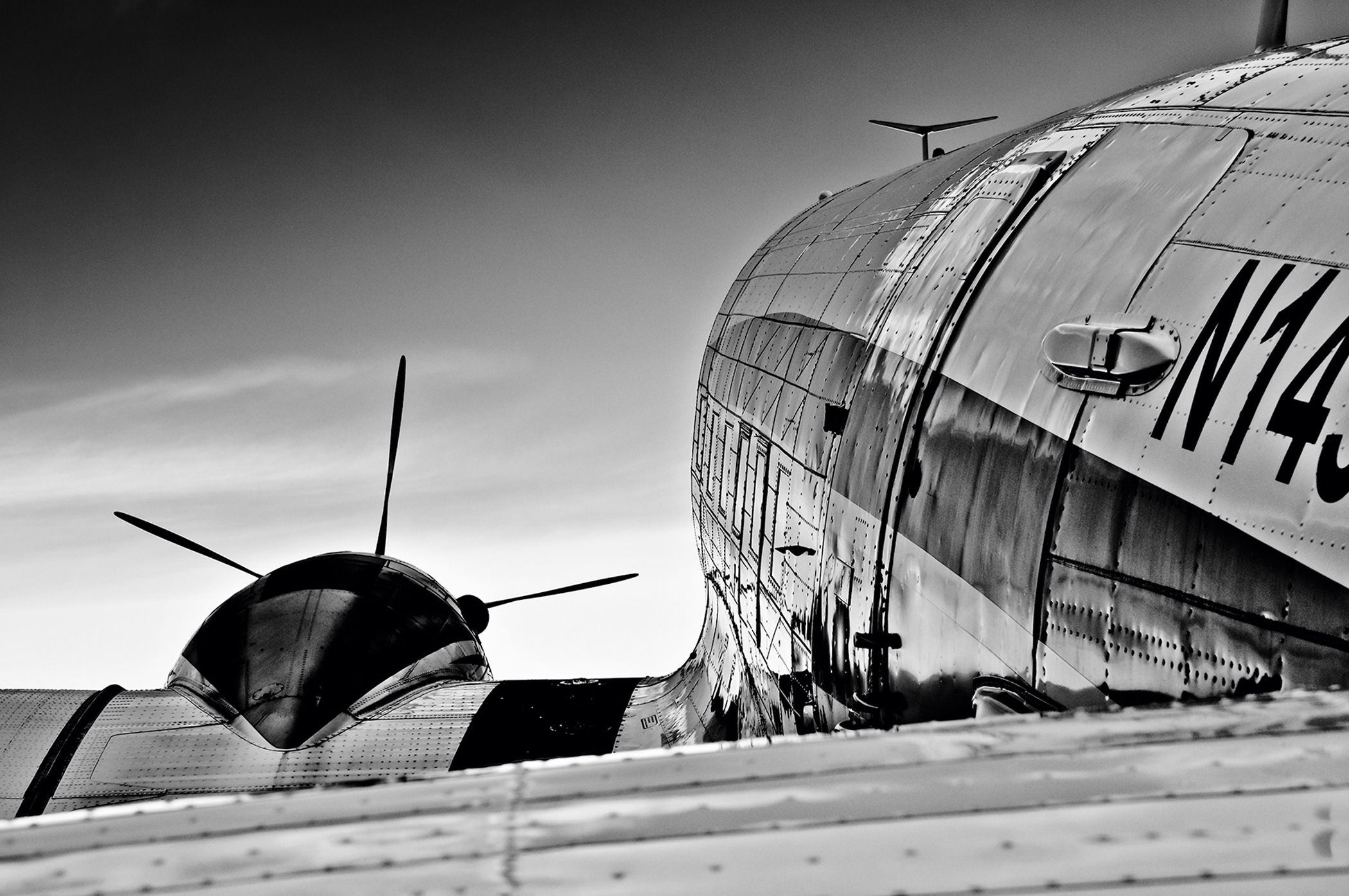 Connoisseurs will recognise the DC-3s used to fight against Nazi Germany and the Fouga Magisters from the Patrouille de France. Black and white sublimates the lines of the aircraft. Whilst light reflects upon the cabin and the wings, one cannot help but think about 'L'Albatros' by Baudelaire pathetically letting their great white wings trail beside them.