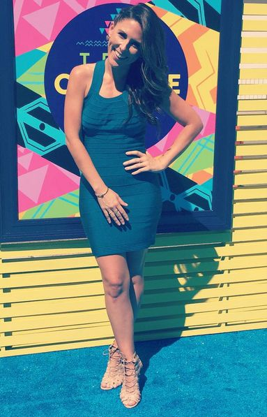 55d61a3c1f4 Clevver TV host Joslyn Davis wore a dress by Mac Duggal while hosting  interviews for on the Red Carpet at the Teen Choice Awards 2015.