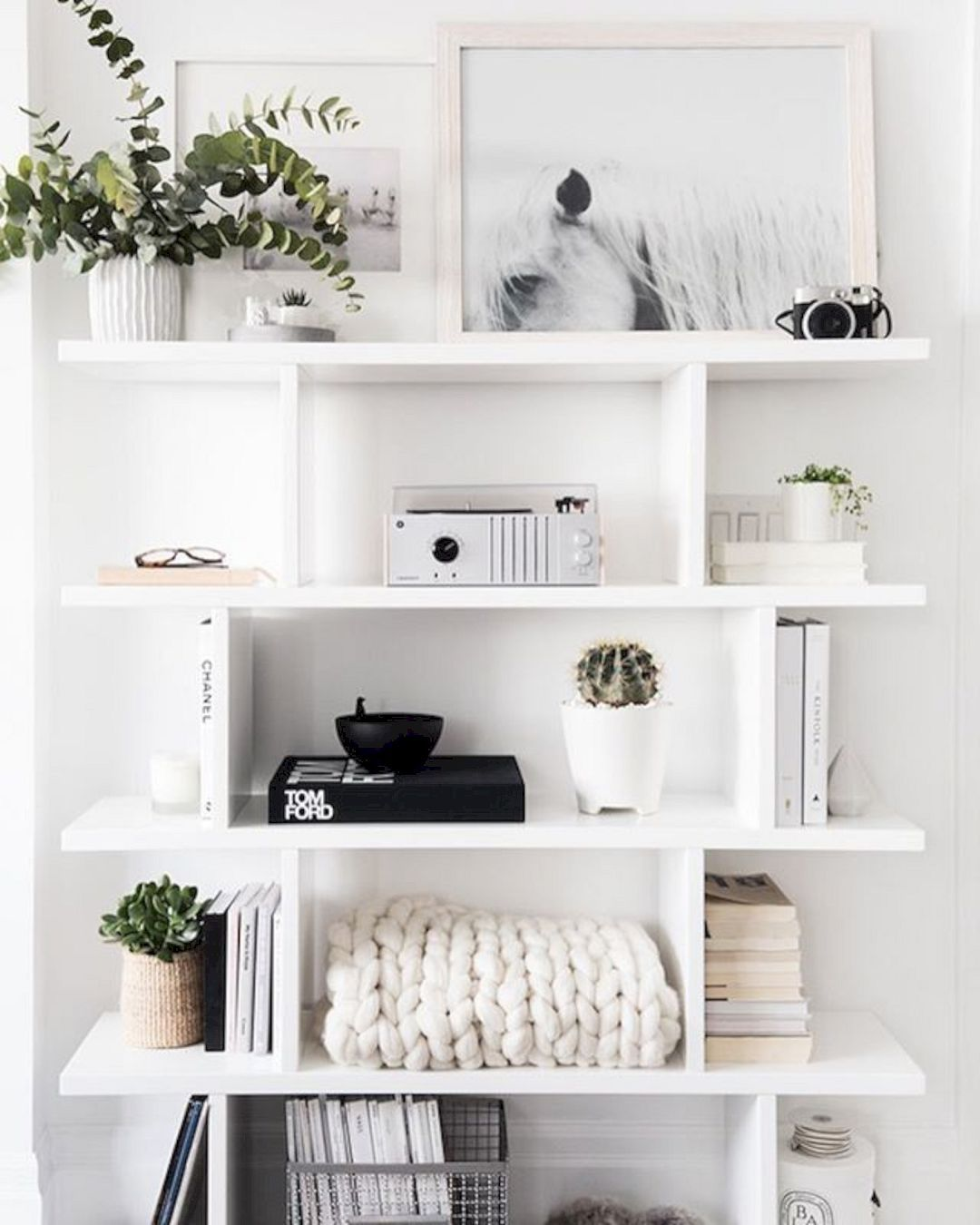 Minimal shelving white green black color scheme home inspiration