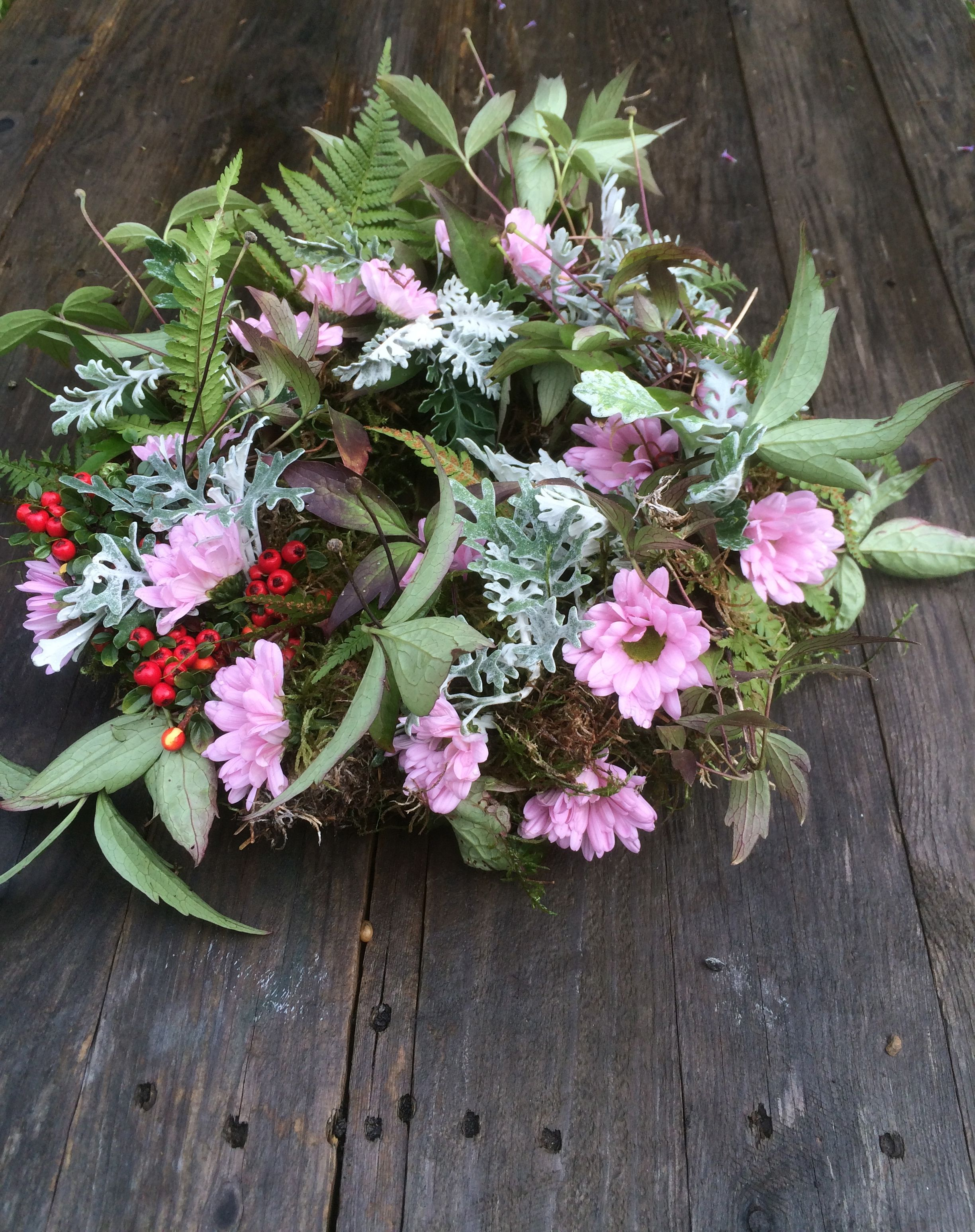 Autumn funeral wreath mossed wire wreath with clematis vine ferns autumn funeral wreath mossed wire wreath with clematis vine ferns cotoneaster berries and small pale pink chrysanthemums tuckshop flowers birmingham izmirmasajfo