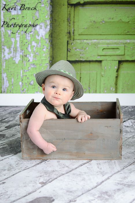 4752cc80ba4c 6 month baby boy photo shoot session idea. Baby sitting in a crate with a  hat on and his dad tie. Six month old pictures for fun photography ideas.