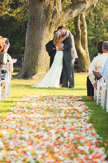 I could totally get married under a big tree with rose petals scattered down the aisle... :)