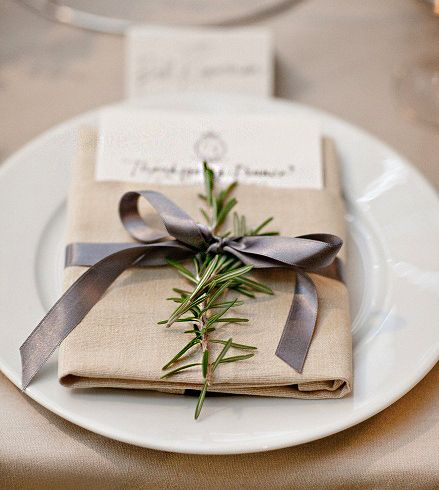 ribbon wrapped around napkin at place setting sprig of